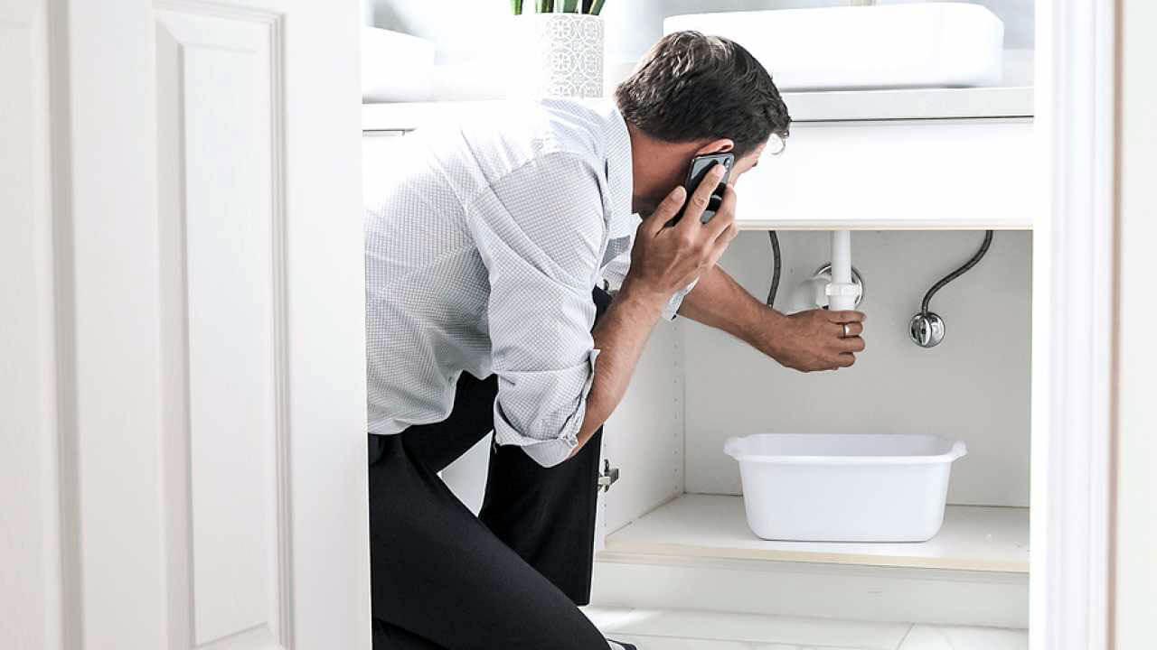 man having problems with bathroom pipes